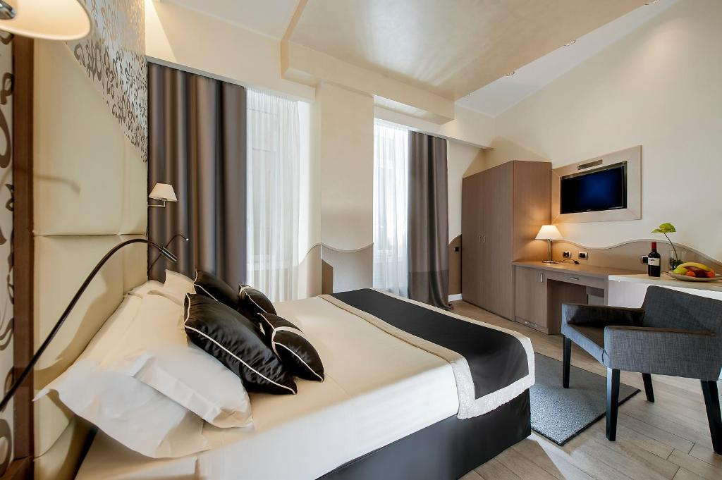 A bed or beds in a room at Demetra Hotel