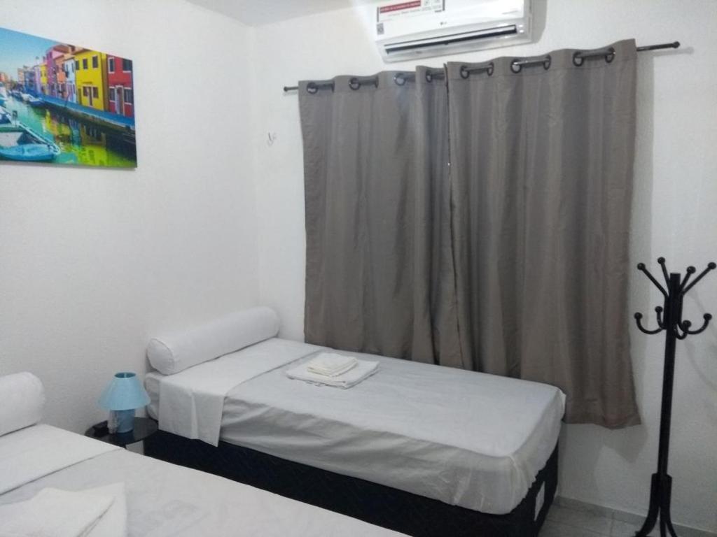 Cama ou camas em um quarto em Fortal Flat
