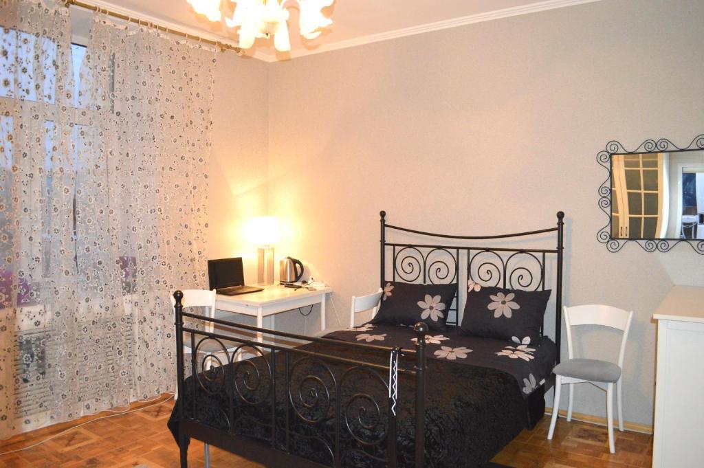 Кровать или кровати в номере Апартамент Тверская17 Центр.