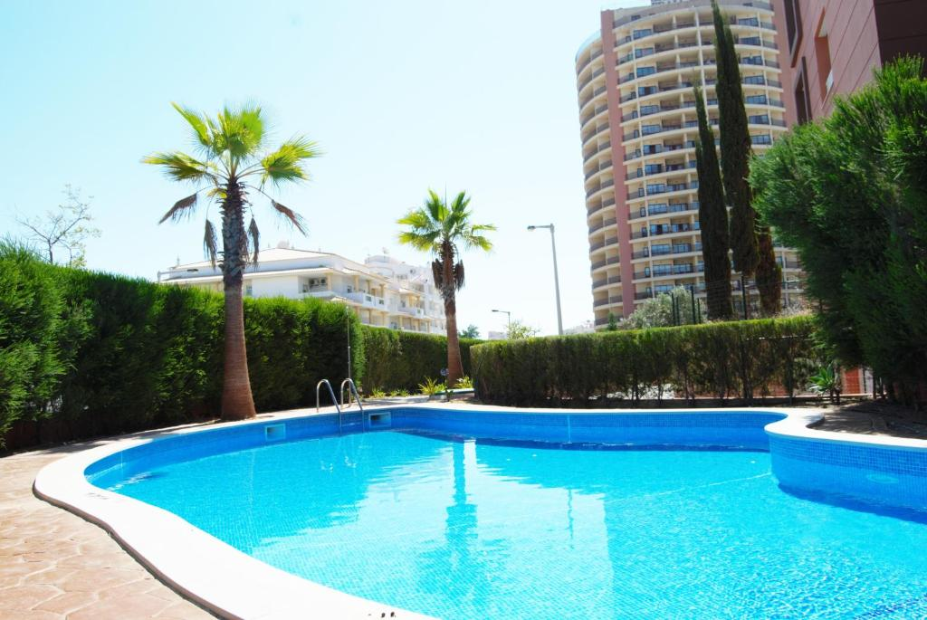 The swimming pool at or near Beach View Apartment