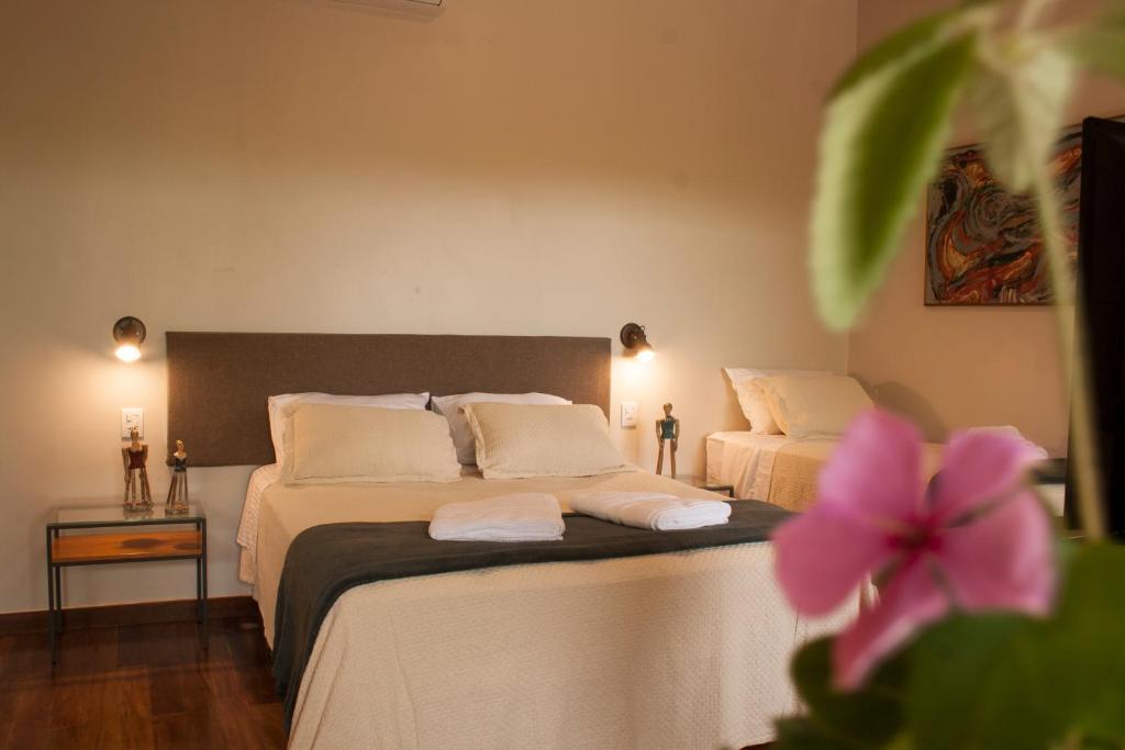 Cama ou camas em um quarto em Villa Domaso