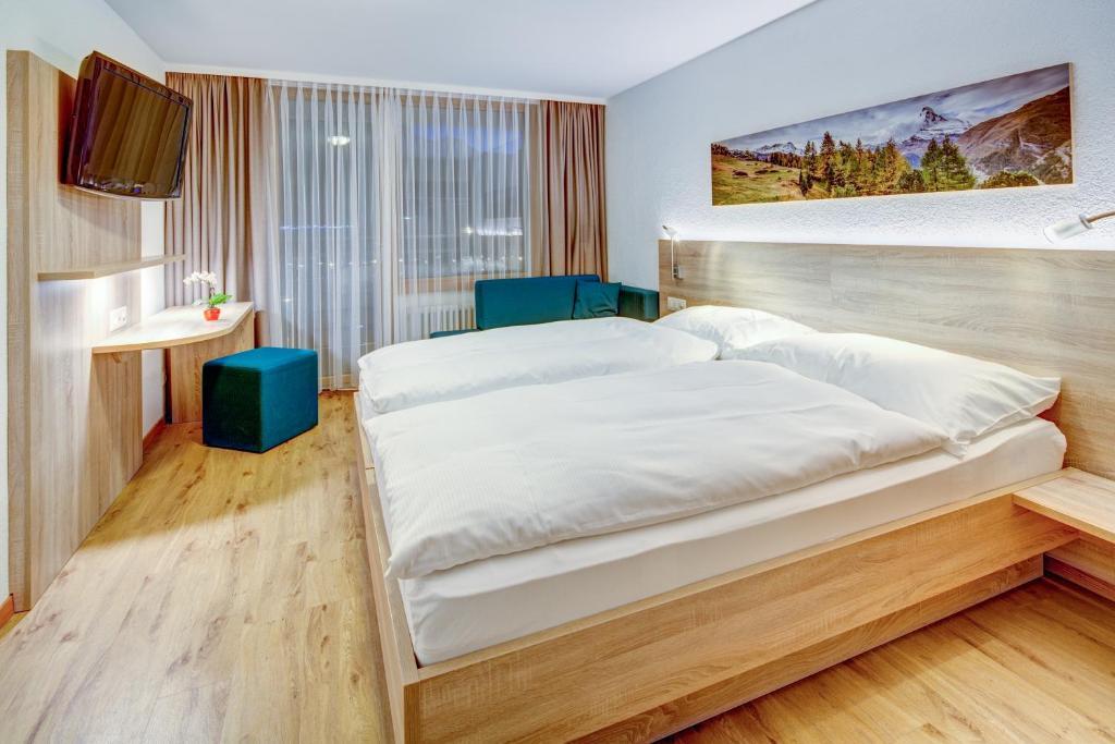 Un ou plusieurs lits dans un hébergement de l'établissement Matterhorn Inn