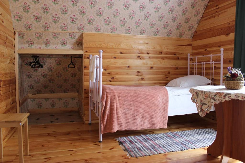 A bed or beds in a room at Гостевой дом