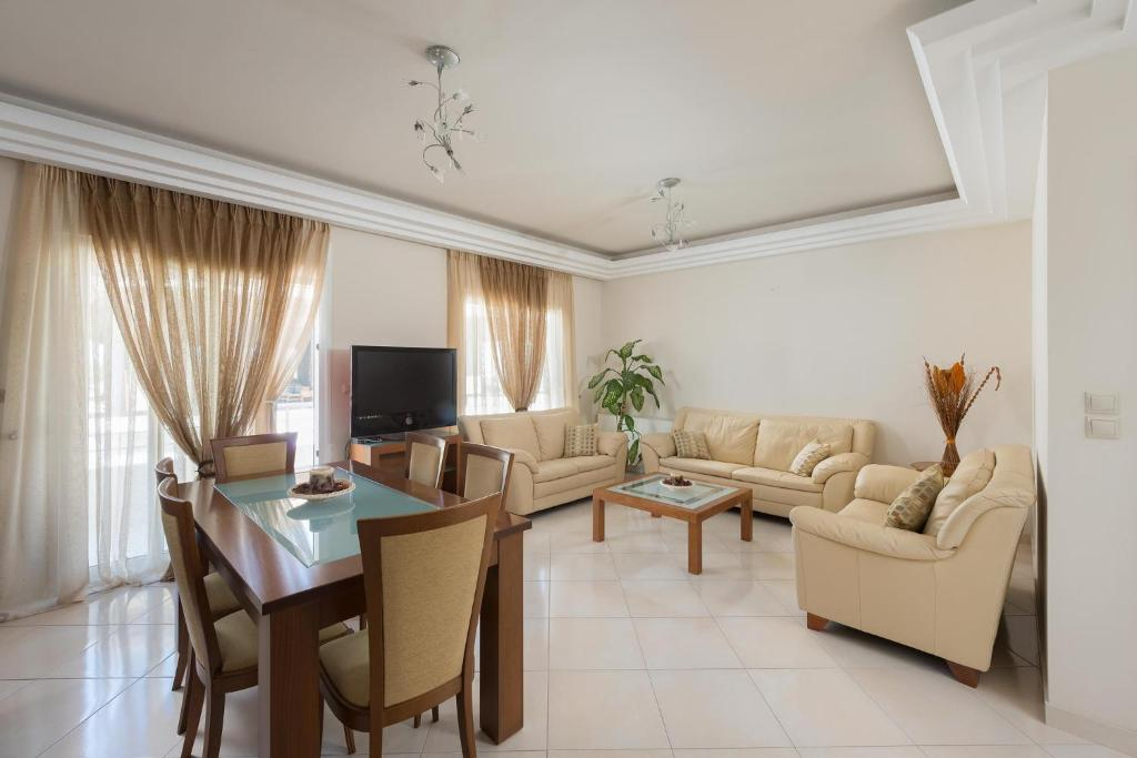 A seating area at Family apartment near the sea
