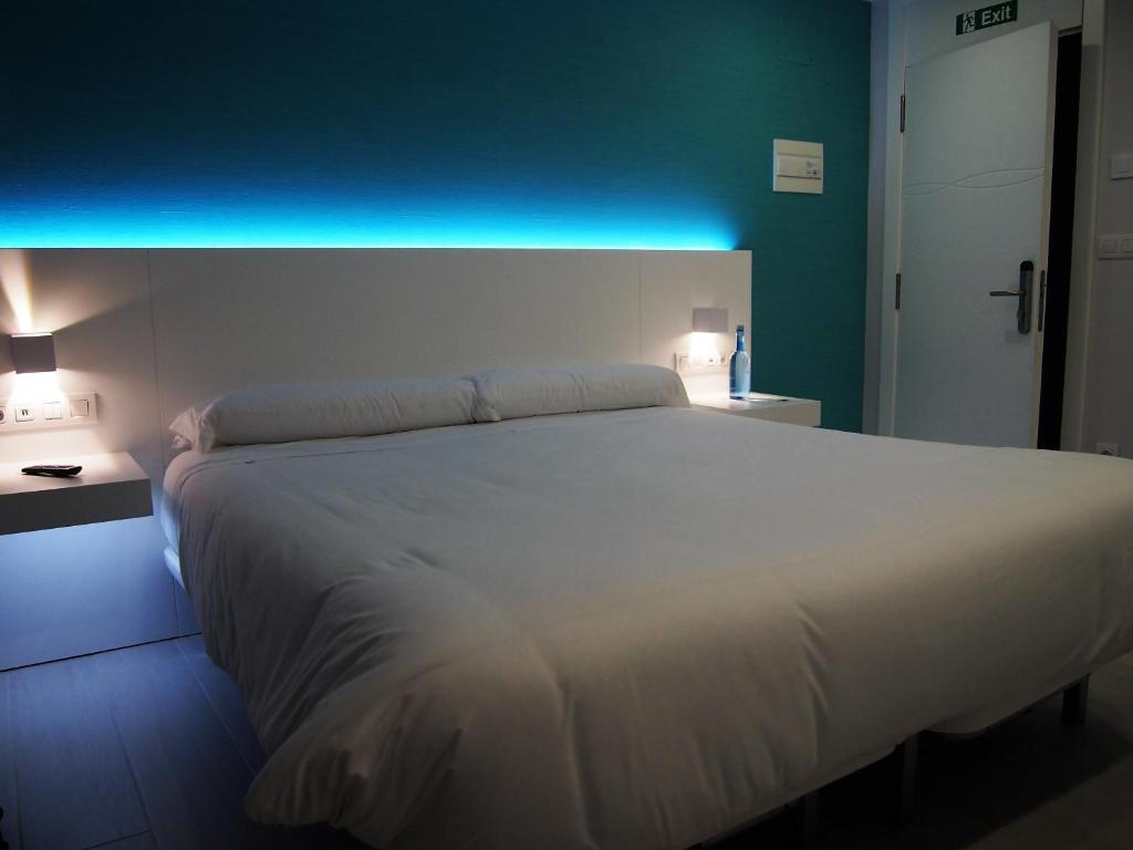 A bed or beds in a room at A de Loló - Four Rooms