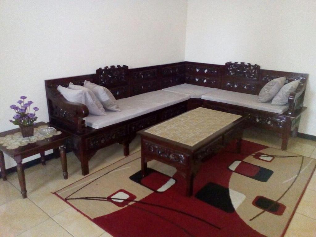 A seating area at Azalea Homestay