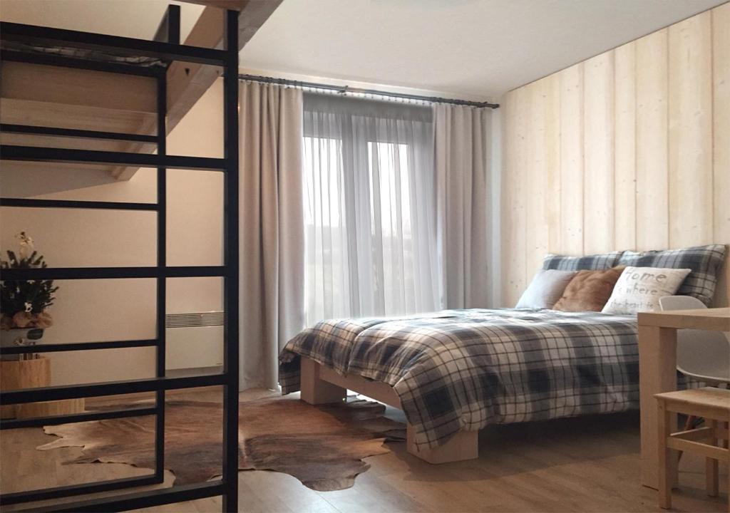 Postel nebo postele na pokoji v ubytování Apartmány na sjezdovce Dolní Morava