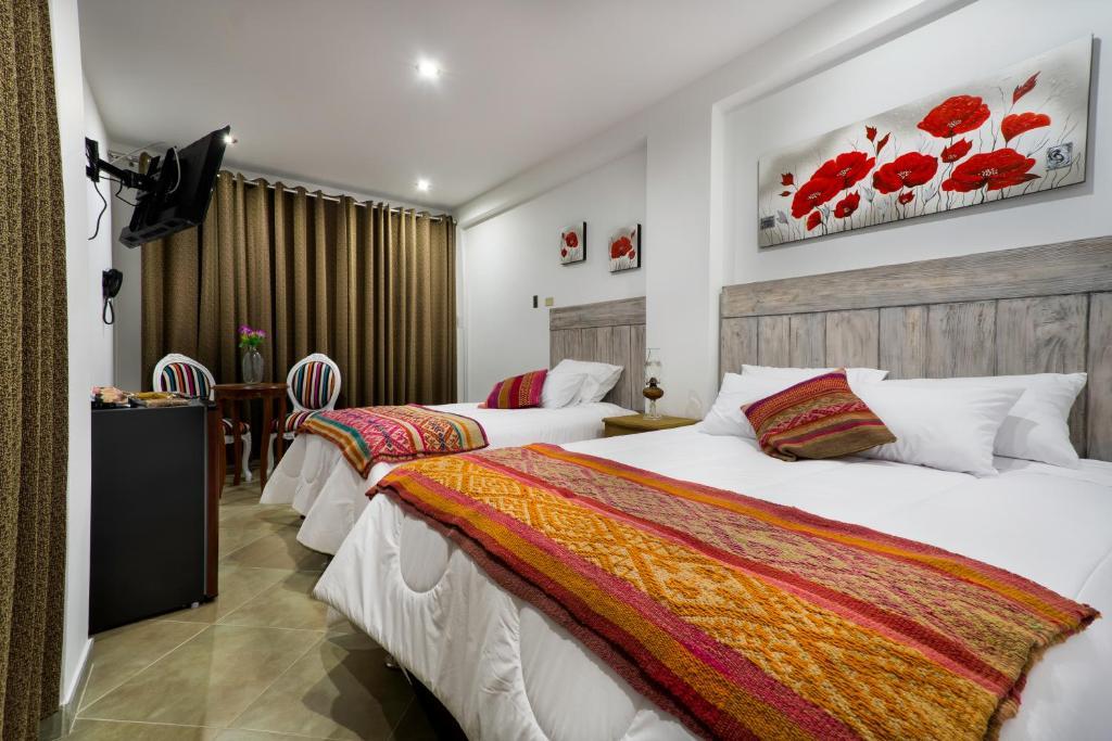 A bed or beds in a room at El Encanto