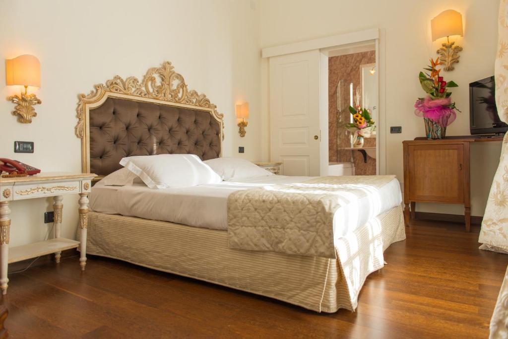 Letto o letti in una camera di Grand Hotel Di Lecce