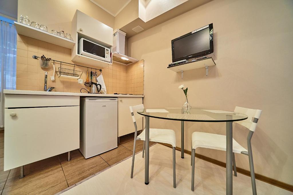 Телевизор и/или развлекательный центр в Apartment near Academy of Arts and Blagovechensky bridge