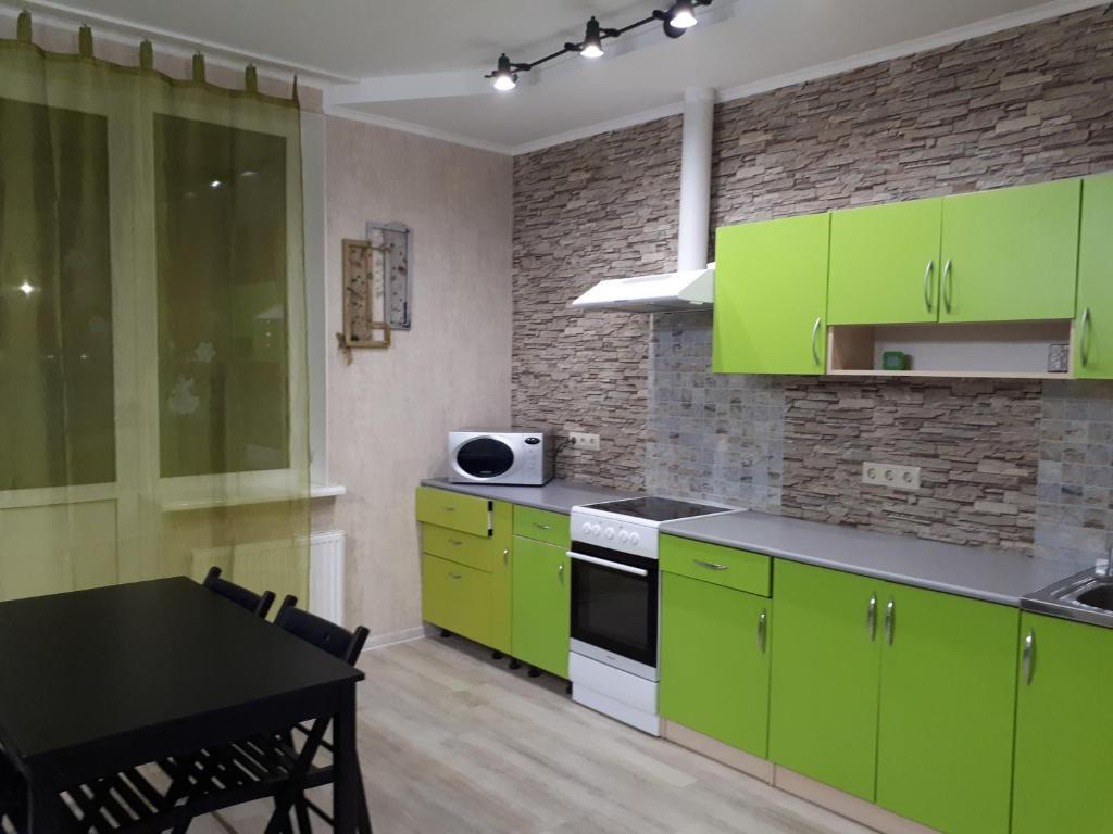 Кухня или мини-кухня в Orbita on Akademicheskaya