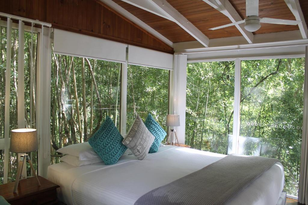 A bed or beds in a room at Kondalilla Eco Resort