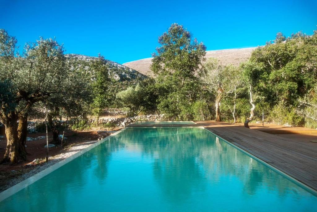 The swimming pool at or near Cooking and Nature - Emotional Hotel