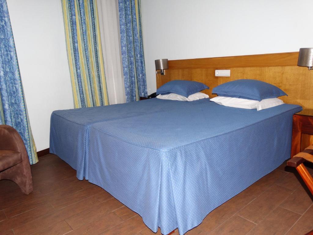 A bed or beds in a room at AL Center Aveiro - Alojamento Local