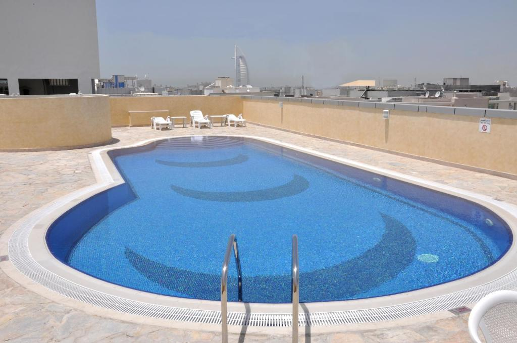 The swimming pool at or near Akas-Inn Hotel Apartment