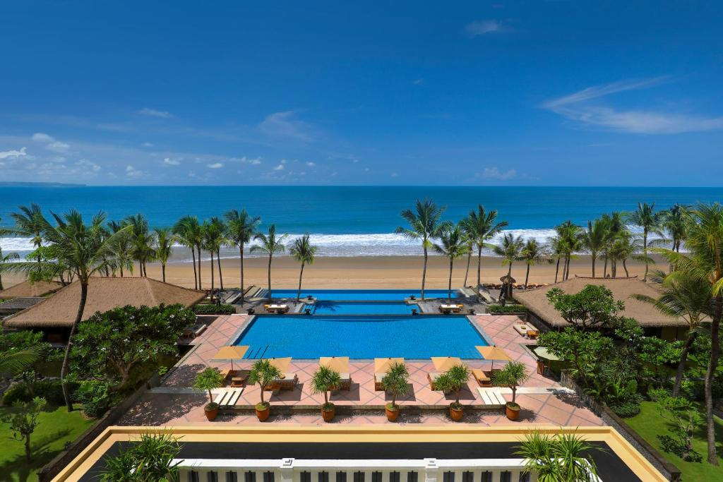 A view of the pool at The Legian Bali or nearby