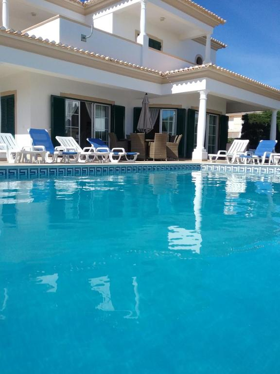 The swimming pool at or near Casa Cereja 'Adults only'