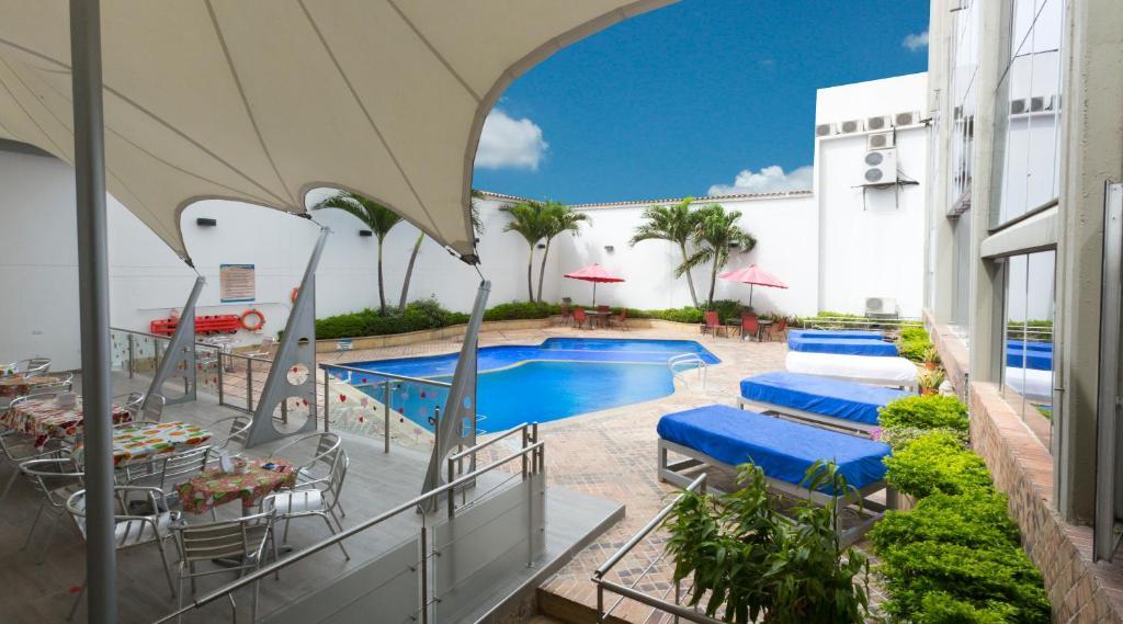 The swimming pool at or near Atlantis Plaza Hotel