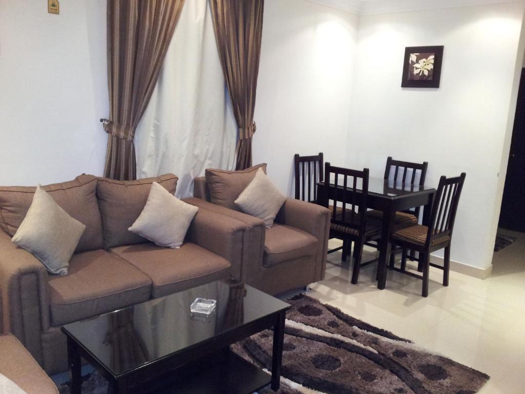Uma área de estar em Dorar Darea Hotel Apartments - Al Malqa