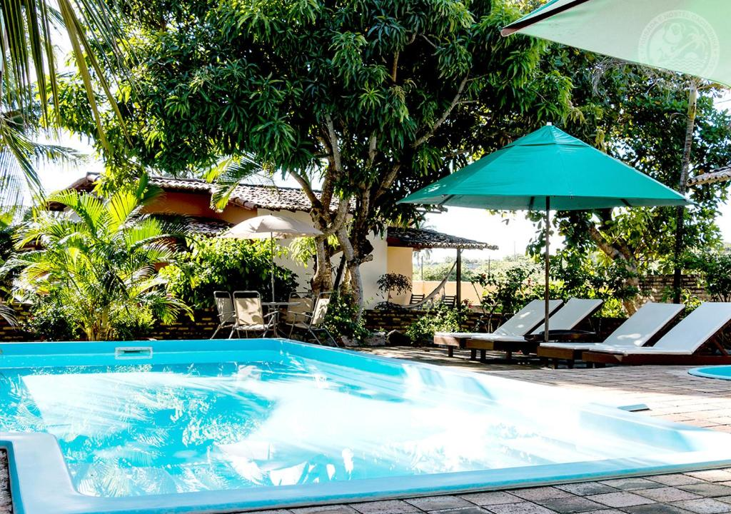The swimming pool at or close to Pousada Cacimbinha - ePipa Hotéis