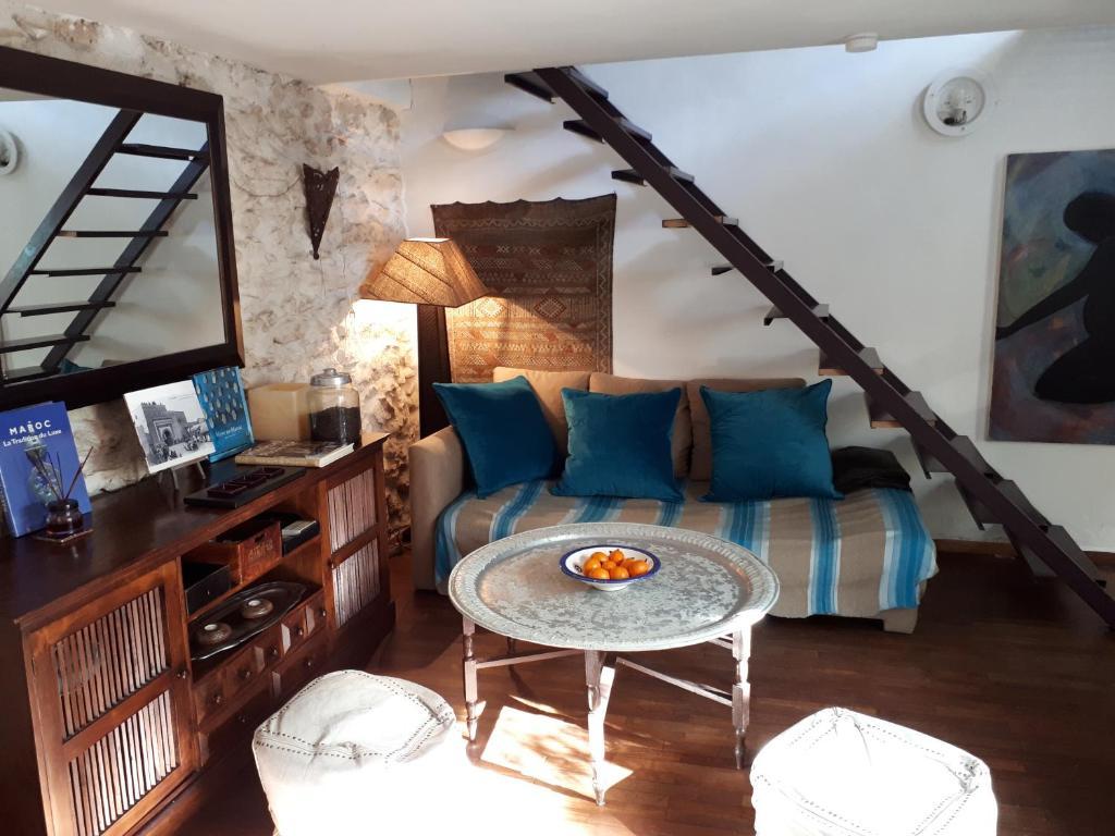 A seating area at Maison de Ville