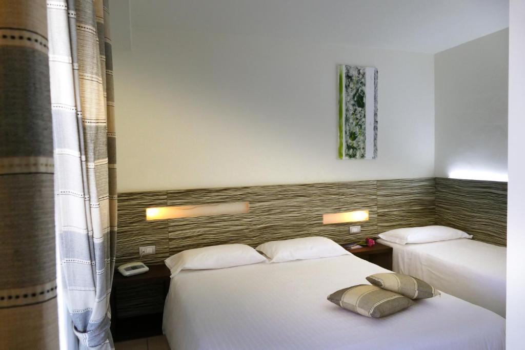 Letto o letti in una camera di Hotel Village Scoglio Della Galea