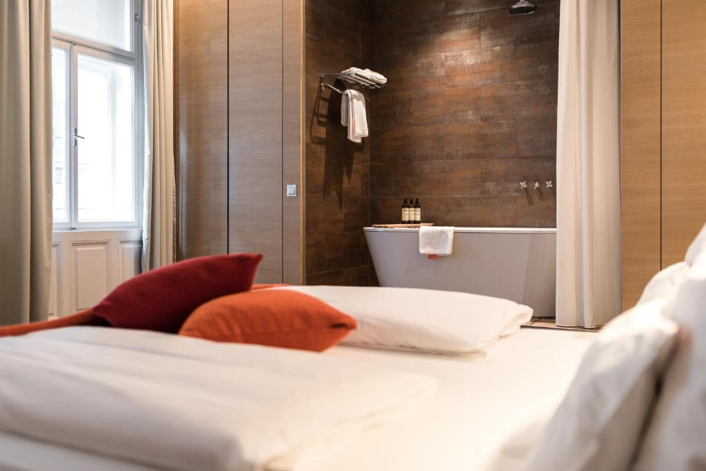 A bed or beds in a room at Hollmann Beletage Design & Boutique Hotel