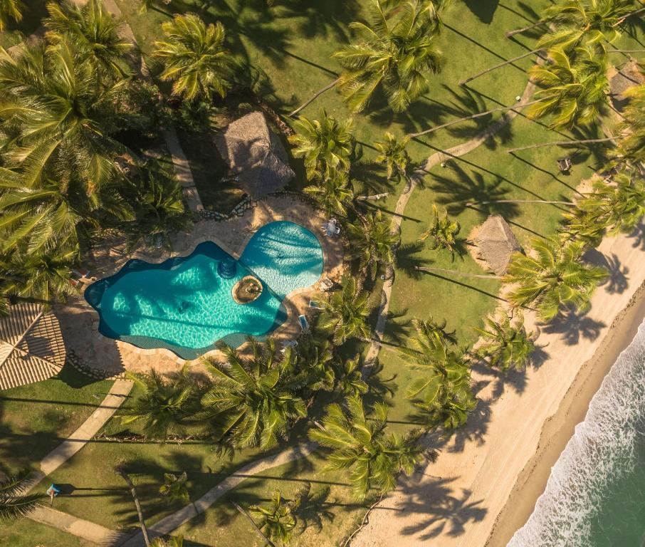 Uma vista da piscina em Pousada Xalés de Maracaípe ou nos arredores