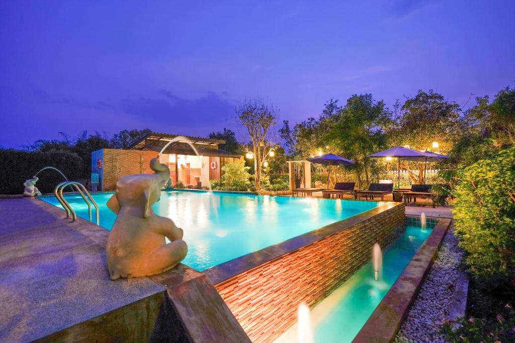 The swimming pool at or near Vieng Tawan Sukhothai Hotel by Thai Thai