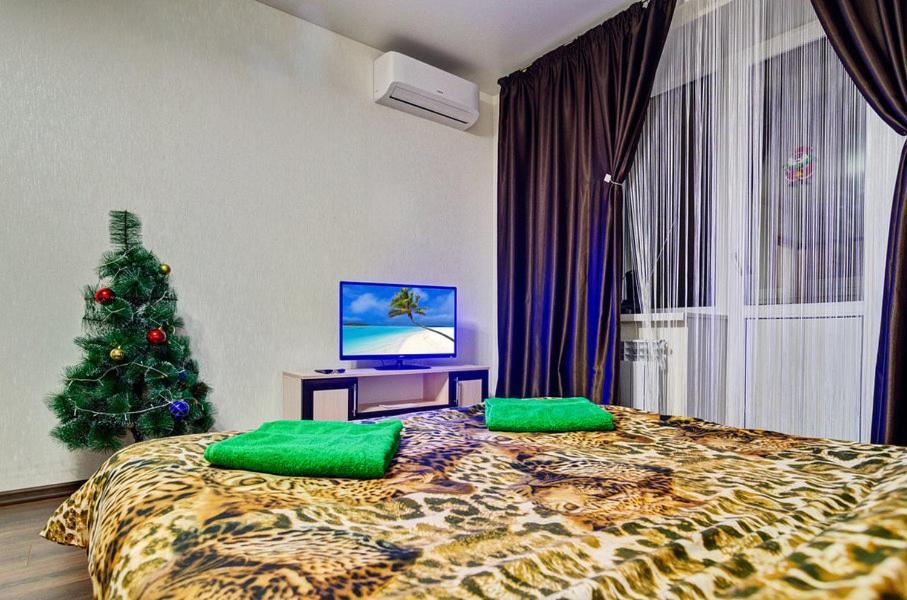 Кровать или кровати в номере Апартаменты на ул. Чкалова, д. 19