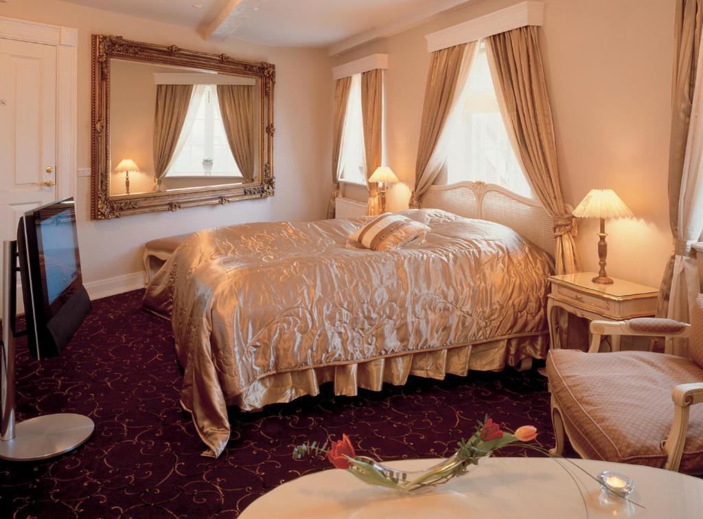 En eller flere senge i et værelse på Tyrstrup Kro