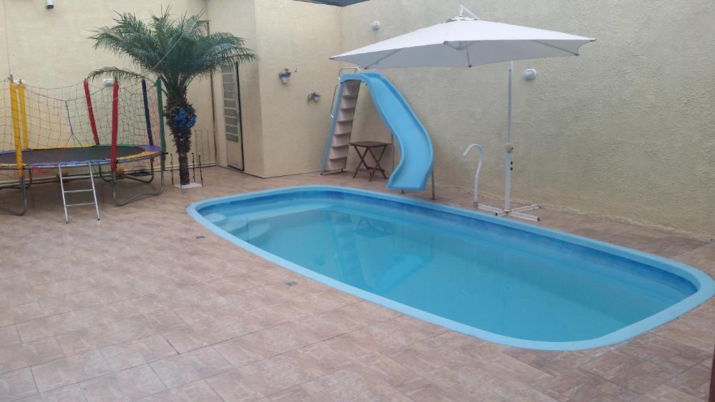 A piscina localizada em Casa segura e tranquila ou nos arredores