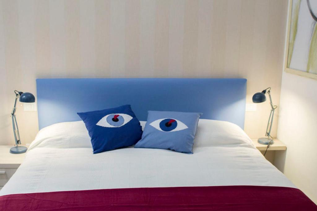 A bed or beds in a room at Il B&B della Mamma