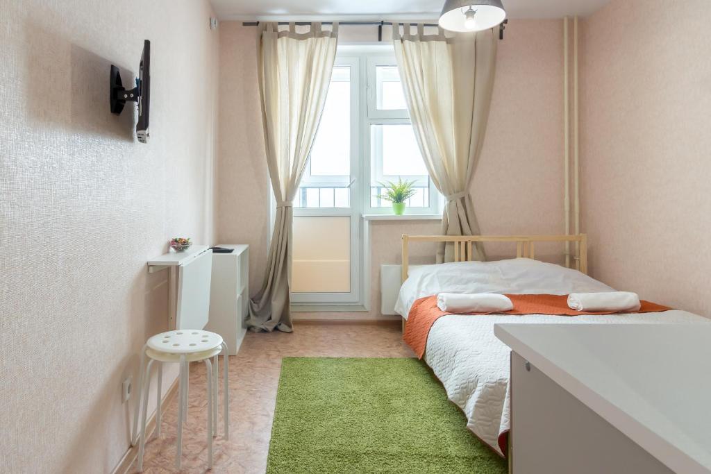 Кровать или кровати в номере Апартамент на Бурнаковской