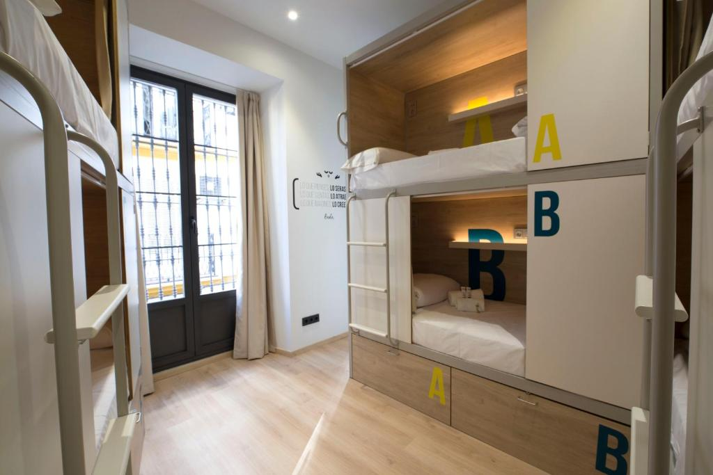 A bunk bed or bunk beds in a room at For You Hostel Sevilla