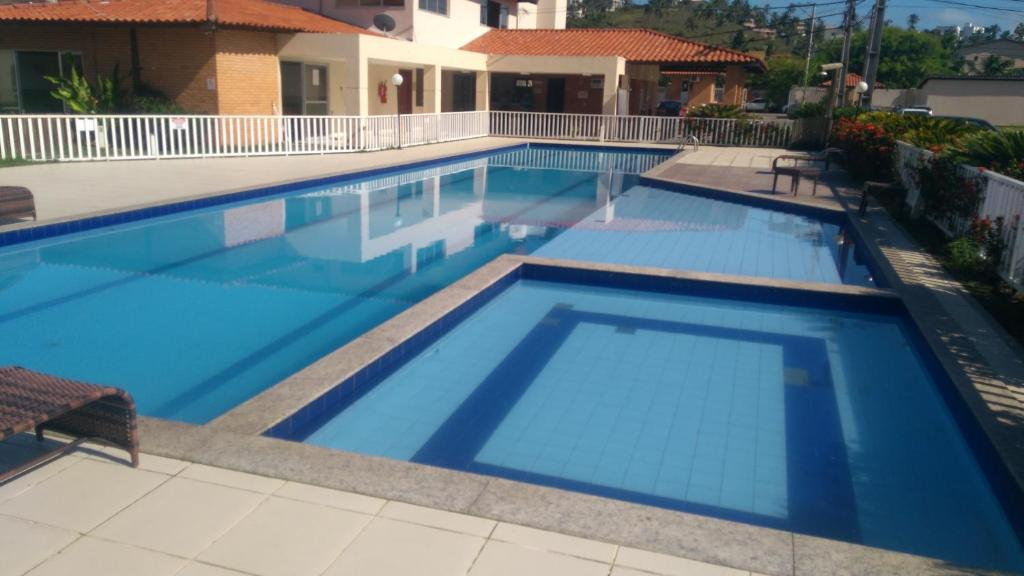The swimming pool at or near Paraiso em Iheus