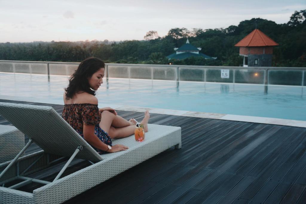 The swimming pool at or near The Evitel Resort Ubud