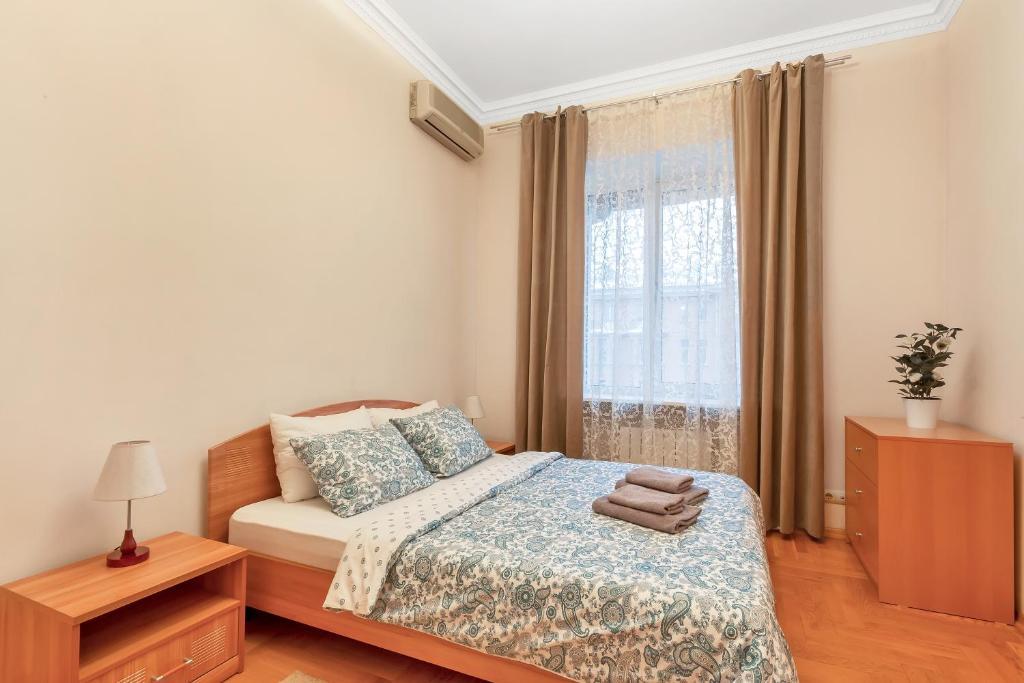 Кровать или кровати в номере HomeBooking Apartments Tverskaya