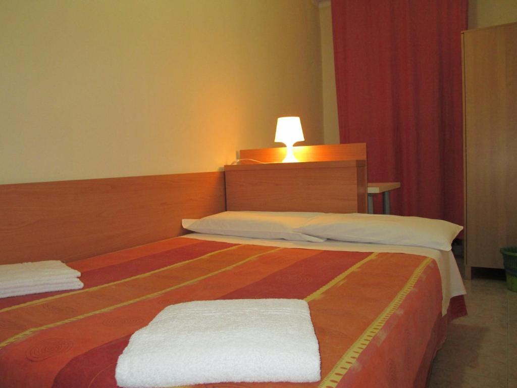 Un ou plusieurs lits dans un hébergement de l'établissement Affittacamere Hostel 3