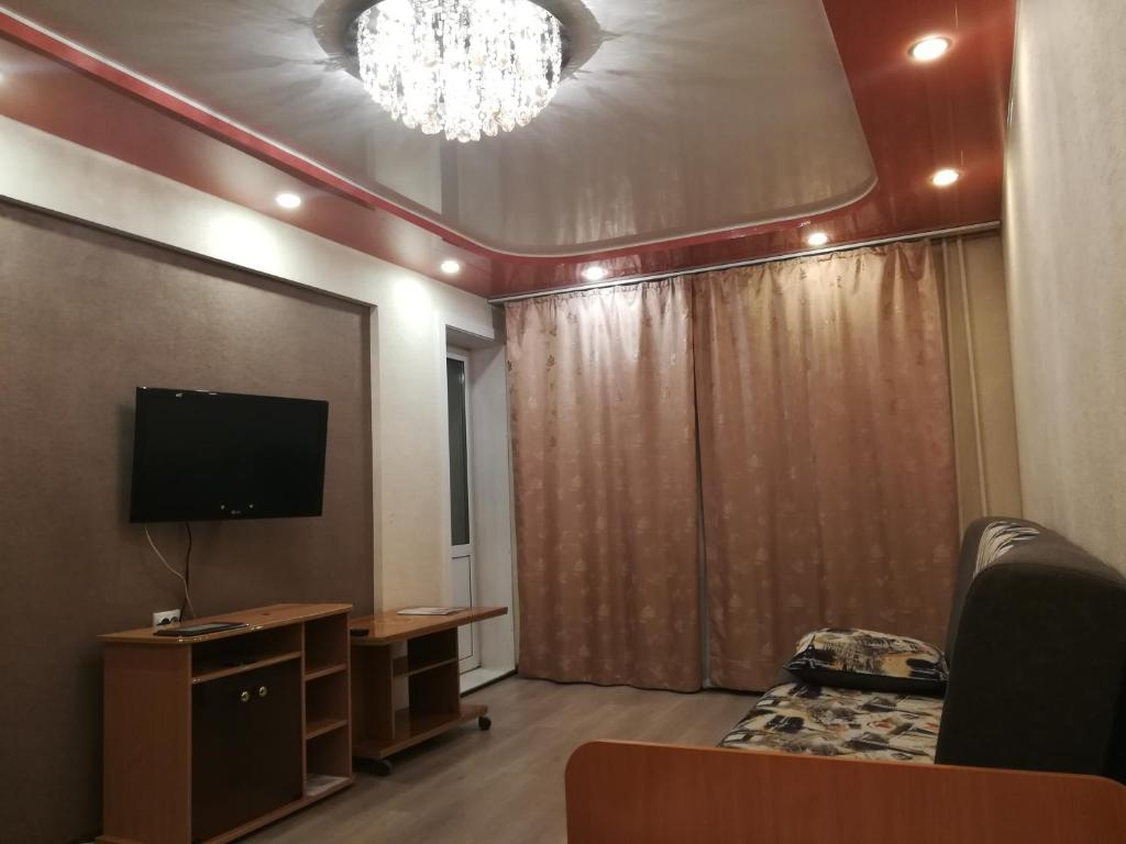 Телевизор и/или развлекательный центр в Apartments 17a quarter, 28
