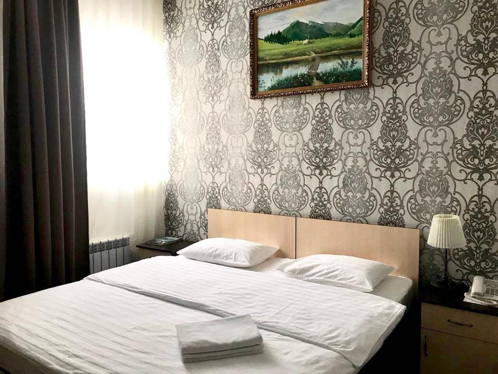 A bed or beds in a room at Mini-Hotel Pulsar