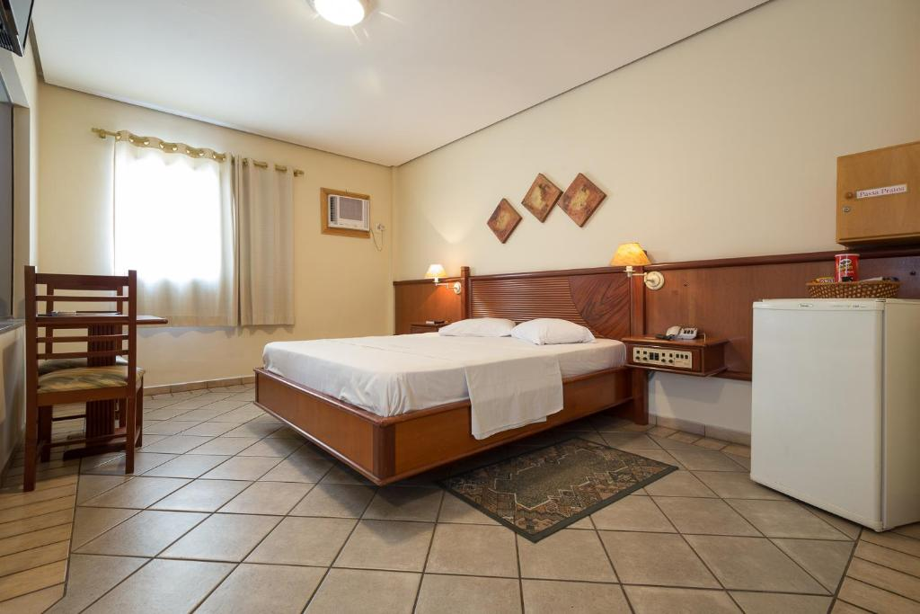 A bed or beds in a room at Requint Hotel