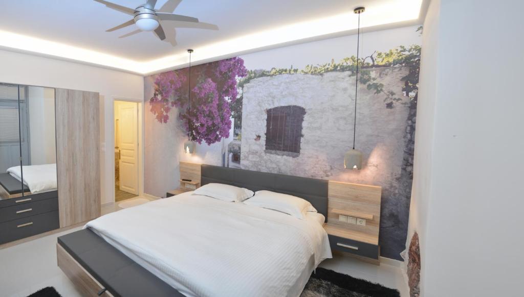 Ένα ή περισσότερα κρεβάτια σε δωμάτιο στο Paradiso