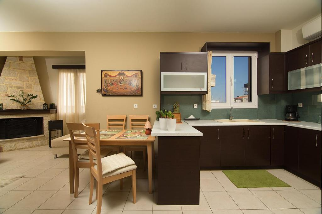 A kitchen or kitchenette at Home Suites