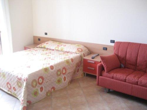 A bed or beds in a room at Al Campanile