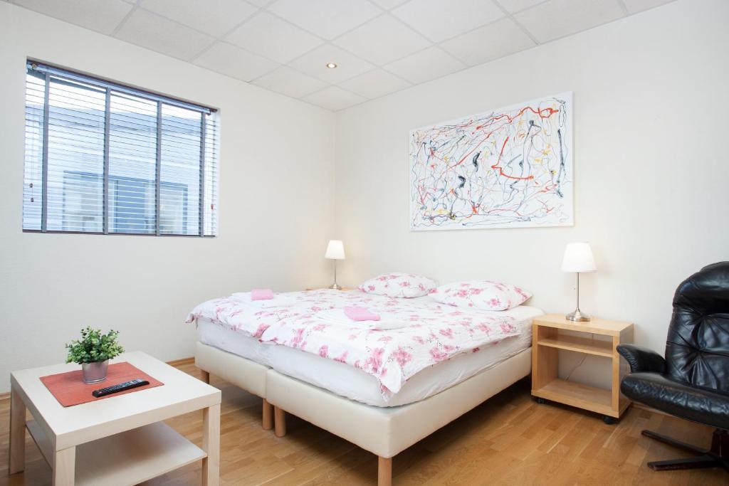 Ein Bett oder Betten in einem Zimmer der Unterkunft T10 Hotel Iceland