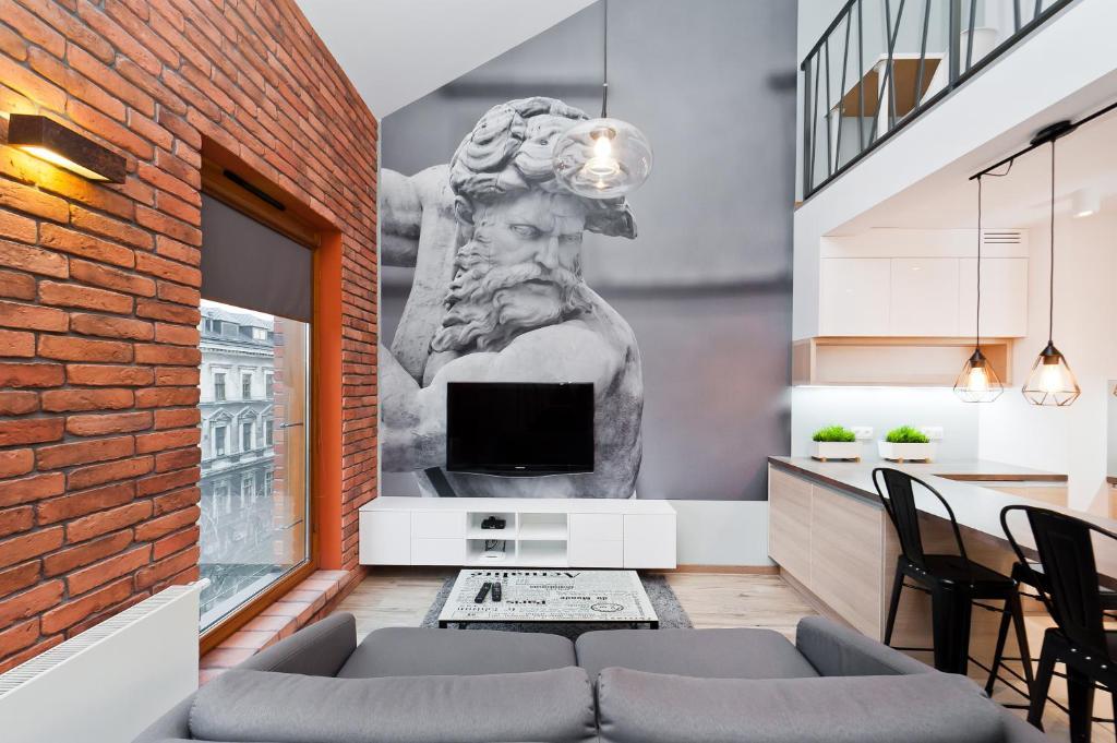 Telewizja i/lub zestaw kina domowego w obiekcie Apartamenty Sun & Snow Olimp Apartments