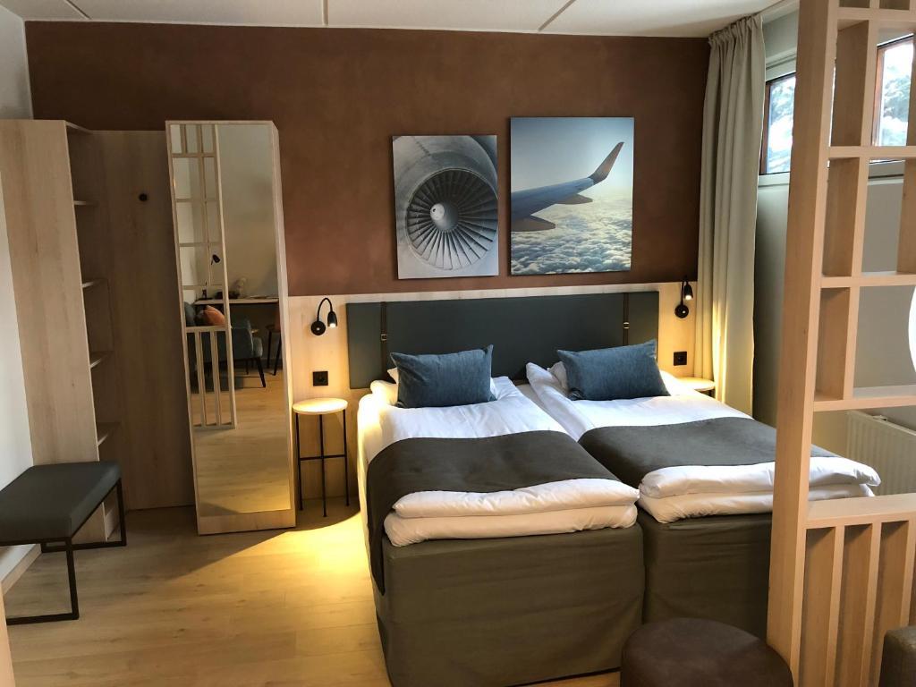 Letto o letti in una camera di Pilot Airport Hotel