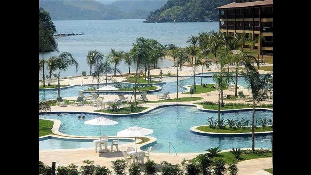 A view of the pool at Apto dentro de Resort com vista para o mar or nearby