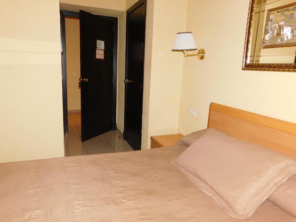 Ліжко або ліжка в номері Hotel Roma